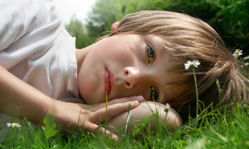 iStock_boy_grass_Medium